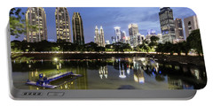 Reflection Of Jakarta Business District Skyline During Blue Hour Portable Battery Charger