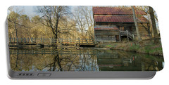 Portable Battery Charger featuring the photograph Reflection On A Grist Mill by George Randy Bass