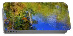 Portable Battery Charger featuring the photograph Reflections In A Pond by Gary Hall