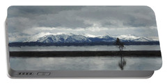 Reflections In Lake Yellowstone Portable Battery Charger by Jayne Wilson