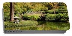 Portable Battery Charger featuring the photograph Reflections In The Japanese Garden by Iris Greenwell