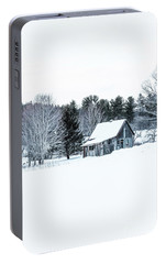 Portable Battery Charger featuring the photograph Remote Cabin In Winter by Edward Fielding