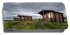 Portable Battery Charger featuring the photograph Remote Cabins Myvatn Iceland by Edward Fielding
