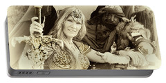 Portable Battery Charger featuring the photograph Renaissance Festival Barbarians by Bob Christopher