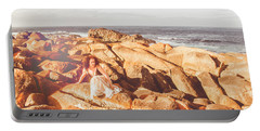 Resting On A Cliff Near The Ocean Portable Battery Charger