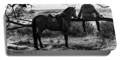 Portable Battery Charger featuring the photograph Rider And Horse Taking Break by Pradeep Raja Prints