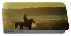 Portable Battery Charger featuring the photograph Riding His Horse by Pradeep Raja Prints