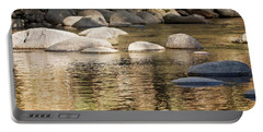 Portable Battery Charger featuring the photograph Ripples And Rocks by Linda Lees