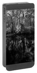 Portable Battery Charger featuring the photograph River Bank Palmetto by Marvin Spates
