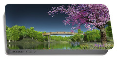 Portable Battery Charger featuring the digital art River Bridge Cherry Tree Blosson by Walter Colvin