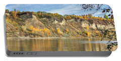 Riverbank In Autumn Portable Battery Charger