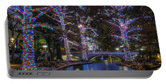 Portable Battery Charger featuring the photograph Riverwalk Christmas by Steven Sparks