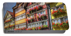 Portable Battery Charger featuring the photograph Row Of Swiss Houses by Hanny Heim