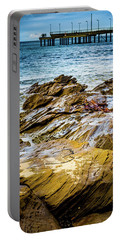 Portable Battery Charger featuring the photograph Rock Pier by Perry Webster