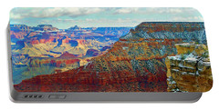 Portable Battery Charger featuring the photograph Rock Solid by Roberta Byram