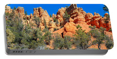 Portable Battery Charger featuring the photograph Rocky Range At Red Canyon by John M Bailey