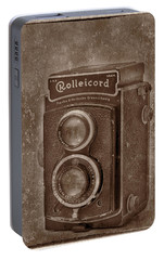 Portable Battery Charger featuring the photograph Rollie by Keith Hawley
