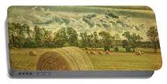 Portable Battery Charger featuring the photograph Rollin' Hay by Lewis Mann