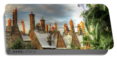 Portable Battery Charger featuring the photograph rooftops Hogsmeade by Tom Prendergast