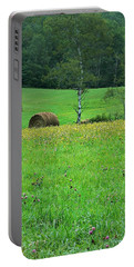 Portable Battery Charger featuring the photograph Round Bale And Wildflowers by Joy Nichols
