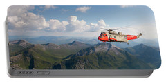 Portable Battery Charger featuring the digital art Royal Navy Sar Sea King by Pat Speirs