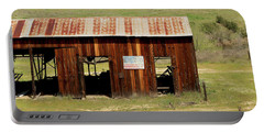 Portable Battery Charger featuring the photograph Rustic Barn With Flag by Art Block Collections