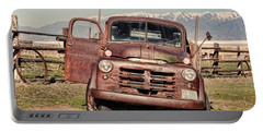 Portable Battery Charger featuring the photograph Rusty Old Dodge by Ely Arsha