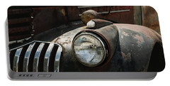 Portable Battery Charger featuring the photograph Rusty Old Headlight  by Kim Hojnacki