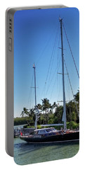 Portable Battery Charger featuring the photograph Sailboat At Royal Harbor by Lars Lentz