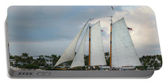 Portable Battery Charger featuring the photograph Sailing In Key West At Dusk by Bob Slitzan