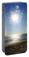 Portable Battery Charger featuring the photograph Salt Spray Sun by Cassandra Buckley