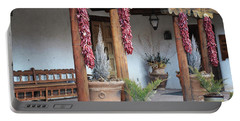 Portable Battery Charger featuring the photograph Santa Fe Red Chili Ristra Porch by Andrea Hazel Ihlefeld