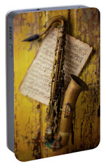 Saxophone Hanging On Old Wall Portable Battery Charger by Garry Gay