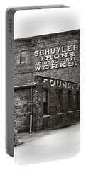 Portable Battery Charger featuring the photograph Schuyler Iron Building Black And White by Trina Ansel