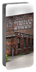 Portable Battery Charger featuring the photograph Schuyler Iron Building by Trina Ansel