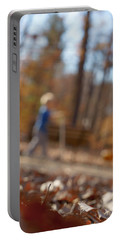 Portable Battery Charger featuring the photograph Scootering At The Park by Greg Collins