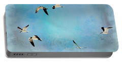 Portable Battery Charger featuring the photograph Sea Gulls In Flight by Athala Carole Bruckner