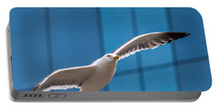 Seabird Flying On The Glass Building Background Portable Battery Charger