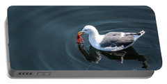 Portable Battery Charger featuring the photograph Seagull Feasting On Crab by Suzanne Luft