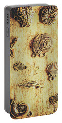 Seashell Shaped Pendants On Wooden Background Portable Battery Charger