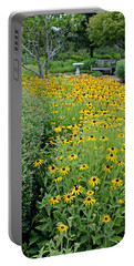 Portable Battery Charger featuring the photograph Secret Garden by Judy Vincent