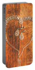 Set Of Brilliant Jewellery On Wooden Background Portable Battery Charger