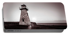 Portable Battery Charger featuring the photograph Setting Sun At Cape Tryon Lighthouse by Chris Bordeleau