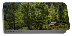Portable Battery Charger featuring the photograph Shed In The Slovenian Alps by Stuart Litoff