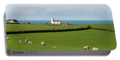 Portable Battery Charger featuring the photograph Sheep Grazing On Irish Coastline by Juli Scalzi