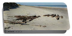 Portable Battery Charger featuring the photograph Shipwreck On The Beach by Liza Eckardt