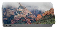 Portable Battery Charger featuring the photograph Shrouded In Clouds by Phyllis Denton