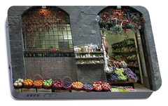 Portable Battery Charger featuring the photograph Siena Italy Fruit Shop by Mark Czerniec