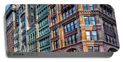 Portable Battery Charger featuring the photograph Sights In New York City - Colorful Buildings by Walt Foegelle