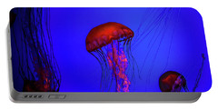 Portable Battery Charger featuring the photograph Silent Jellies by Jeff Folger